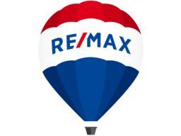 RE/MAX ImmobilienPartner Ostfriesland - Krummhörn Logo